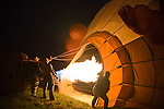 """Hot air balloonists  at the 2008 Shenandoah Valley Hot Air Balloon Festival at Historic Long Branch in Millwood, Virginia fire a propane burner to heat the air in the balloon """"envelope.""""  Since hot air rises, this will eventually cause the balloon to stand up, then fly up."""