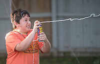 NWA Democrat-Gazette/ANTHONY REYES &bull; @NWATONYR<br /> Briggs Engelmann, 10, sprays silly string during a battle Monday June 22, 2015 during the &ldquo;Vacation Bible School Xtreme&quot; at Robinson Avenue Church of Christ in Springdale. The theme of the program is building each other up and the night's focus was on using words to do that.