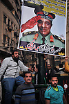 Poster showing a face cut in two part, on side the last president Mubarak, on the other side the chief of military council marechal tantaoui. For the fifth consecutive day, the incidents have been multiplied Wednesday between protesters demanding the immediate departure of the military power and security forces.