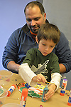 Garden City, New York, U.S. January 20, 2014. JESSE RIVERA and his son JADEN RIVERA, 4, of Sea Cliff, create artwork of peace at the program Dreaming with Dr. Martin Luther King, Jr. where children also explored Dr. King's life, at the Long Island Children's Museum, to celebrate the American official federal holiday Birthday of Martin Luther King, Jr.