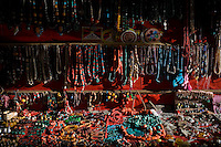 An array of Ladakhi jewellery are hung up for display and sale in Leh, Ladakh, Jammu & Kashmir, on 31st May 2009. Life and business in and around Leh town come to life as the first tourists arrive before summer season in this town of 3505m in the Himalayan mountains, India.  Photo by Suzanne Lee