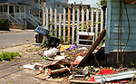 WATERBURY,  CT-051917JS06-A pile of trash sits outside a home on Locust Street in Waterbury on Friday. <br />  Jim Shannon Republican-American
