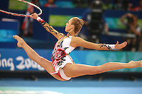 August 23, 2008; Beijing, China; Rhythmic gymnast Inna Zhukova of Belarus split leaps to re-catch hoop on way to winning silver in the Individual All-Around final at 2008 Beijing Olympics..(©) Copyright 2008 Tom Theobald