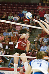 25 SEP 2005<br /> <br /> Illinois State Redbirds Outside Hitter Laura Doornbos sends one over the net with some attached heat.<br /> <br /> The Creighton Bluejays failed to win a single game as the Illinois State Redbirds won 3 in a row to settle the match.  Play took place at Redbird Arena on the campus of Illinois State University in Normal IL.
