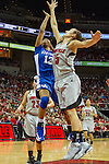 UK sophomore guard Bria Goss goes up for a layup in the face of Louisville freshman guard Megan Deines. in Lexington, Ky., on Sunday, December, 2, 2012. Photo by James Holt | Staff