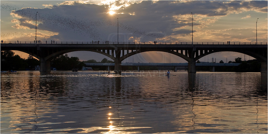 On a summer evening, nearly 1.5 million Mexican free-tailed bats head from their home underneath Congress Bridge in the shadow of downtown Austin in search of food. This image was taken looking west as the sun set over Lady Bird Lake and the Zilker Park area.