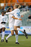 North Carolina's Elizabeth Guess (30) jumps into the arms of Yael Averbuch (17) while celebrating her goal at 1:22 into the game on Friday, November 3rd, 2006 at SAS Stadium in Cary, North Carolina. The University of North Carolina Tarheels defeated the Clemson University Tigers 3-0 in Atlantic Coast Conference Women's Soccer Championship semifinal game.