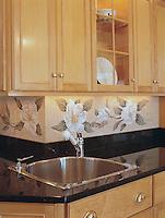 Custom Magnolia marble mosaic in Verde Luna, Verde Alpi, Chartreuse, Thassos, Calacatta Tia, Carrara, Bardiglio, Crema Valencia, Persian Gold, Travertine Noce, Crema marfil