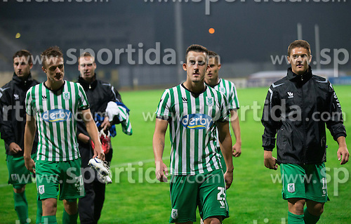 Antonio Mlinar Delamea #20 of Olimpija, Anej Lovrecic #25 of Olimpija, Filip Valencic #11 of Olimpija after the football match between NK Domzale and NK Olimpija in 10th Round of Slovenian First League PrvaLiga NZS 2012/13 on September 23, 2012 in Sports park Domzale, Slovenia. Olimpija defeated Domzale 2-0.  (Photo By Vid Ponikvar / Sportida)