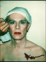 BNPS.co.uk (01202) 558833<br /> Picture: Warhol<br /> <br /> self portrait of Andy Warhol in Drag<br /> <br /> Never-before-seen photographs of celebrities captured in informal moments by the artist Andy Warhol are to be sold. The American pop artist used photography as a medium of art towards the end of his career and had a tendency to snap spontaneous moments. Many of his subjects were showbiz friends who frequented the same nightclubs as Warhol or visited his luxurious beach house or vast 'factory'. They included the likes of John Lennon, Mick Jagger, Elizabeth Taylor, Madonna, Sting, Bruce Springstein, Lizi Minnelli, Diana Ross and Debbie Harry. At the other end of the scale, he also turned his eye to capturing domestic items such as a room service tray, hotel chandeliers and even a row of urinals.