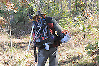 NWA Democrat-Gazette/FLIP PUTTHOFF <br /> Ken McMullin of Springdale carriestools for trail maintenance including weed trimmer, loppers and saw. McMullin worked Oct. 21 2016 clearing the trail corridor near Sweden Creek Falls.