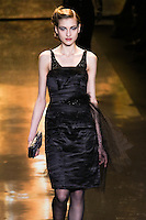 Simona Andrejic walks runway in a jet tulle & taffeta dress, from the Badgley Mischka Fall 2011 fashion show, during Mercedes-Benz Fashion Week Fall 2011.