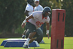 Ole Miss' Gilbert Pena (99) goes through a drill at  football practice in Oxford, Miss. on Sunday, August 7, 2011.