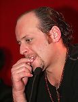 """Moenia pop music band member, Alfonso Pichardo leans on his hand as he talks to reporters during a press conference,in Mexico City March 28, 2006. Moenia received a golden award after selling 50 thousand copies of their last CD """"Hits Live"""". Photo by © Javier Rodriguez"""
