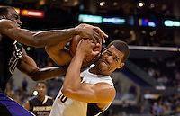 California's Jamal Boykin (right) battles for the ball against Washington's Quincy Pondexter. The Washington Huskies defeated the California Golden Bears 79-75 during the championship game of the Pacific Life Pac-10 Conference Tournament at Staples Center in Los Angeles, California on March 13th, 2010.