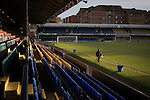 Southend United 1 Burton Albion 1, 22/02/2016. Roots Hall, League One. A groundsman walking in front of the main stand at Roots Hall stadium, pictured before Southend United took on Burton Albion in a League 1 fixture. Founded in 1906, Southend United moved into their current ground in 1955, the construction of which was funded by the club's supporters. Southend won this match by 3-1, watched by a crowd of 6503. Photo by Colin McPherson.