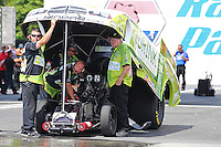 Jun 6, 2015; Englishtown, NJ, USA; Team owner Jim Dunn (right) stands with crew members and NHRA funny car driver John Hale during qualifying for the Summernationals at Old Bridge Township Raceway Park. Mandatory Credit: Mark J. Rebilas-