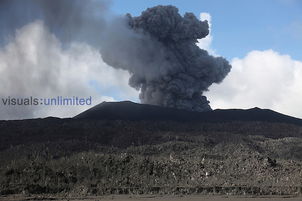 Ash cloud rises from summit crater of Dukono Volcano following explosive eruption, Halmahera, Indonesia.