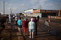 Residents see at the boardwalk in Seaside park where a massive fire that engulfed dozens of businesses September 13, 2013 by Kena Betancur / VIEWpress