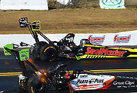Mar 18, 2017; Gainesville , FL, USA; NHRA top fuel driver Troy Coughlin Jr (far) races alongside Clay Millican during qualifying for the Gatornationals at Gainesville Raceway. Mandatory Credit: Mark J. Rebilas-USA TODAY Sports
