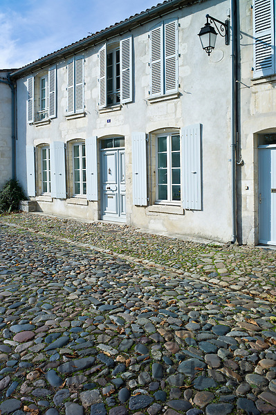 Cobbled stones street scene at St Martin de Re,  Ile de Re, France