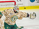25 November 2014: University of Vermont Catamount Goaltender Brody Hoffman, a Junior from Wilkie, Saskatchewan, watches a shot go wide during the third period against the University of Massachusetts Minutemen at Gutterson Fieldhouse in Burlington, Vermont. The Cats defeated the Minutemen 3-1 to sweep the 2-game, home-and-away Hockey East Series. The 12th ranked Catamounts wore their camouflage uniforms for the evening to honor the US military. Mandatory Credit: Ed Wolfstein Photo *** RAW (NEF) Image File Available ***