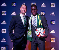 #17 overall pick Schillo Tshuma of the Portland Timbers stands with head coach Caleb Porter during the MLS SuperDraft at the Pennsylvania Convention Center in Philadelphia, PA, on January 16, 2014.