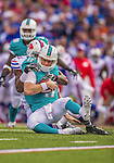 14 September 2014: Miami Dolphins quarterback Ryan Tannehill is taken down by Buffalo Bills defensive end Manny Lawson in the fourth quarter at Ralph Wilson Stadium in Orchard Park, NY. The Bills defeated the Dolphins 29-10 to win their home opener and start the season with a 2-0 record. Mandatory Credit: Ed Wolfstein Photo *** RAW (NEF) Image File Available ***