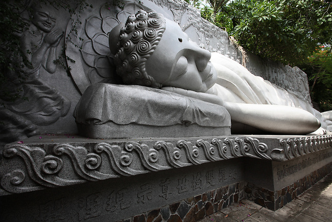 The Giant Sleeping Buddha reclines on a hillside at the Long Son Pagoda in Nha Trang, Vietnam. July 14, 2011.
