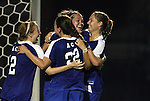 24 September 2009: Duke's KayAnne Gummersall (2nd from right) is mobbed by Rebecca Allen (2), Chelsea Canepa (22), and Carey Goodman (right) after scoring the tying goal in the 89th minute. The University of North Carolina Tar Heels defeated the Duke University Blue Devils 2-1 in sudden victory overtime at Fetzer Field in Chapel Hill, North Carolina in an NCAA Division I Women's college soccer game.