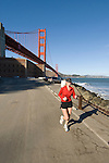 San Francisco, California, Woman enjoying a run east of the Golden Gate Bridge along the Golden Gate Promenade.  Photo copyright Lee Foster.  Photo # 1-casanf76324.