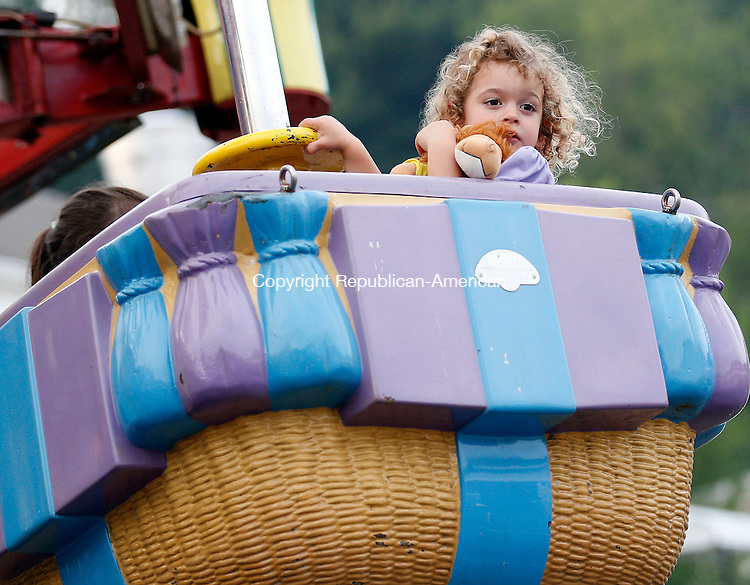 Beacon Falls, CT- 11 June 2015-061115CM06-  Heidi Lamb 3, of Prospect, looks out in the crowd as she rides the Zamperla during the annual Beacon Hose Carnival in Beacon Falls on Thursday.  The rides, food and entertainment continue Friday from 6 p.m. to 11p.m. then on Saturday from 3 p.m. to midnight with a parade at 6 p.m.  The event is put on by Beacon Hose Co. 1.      Christopher Massa Republican-American