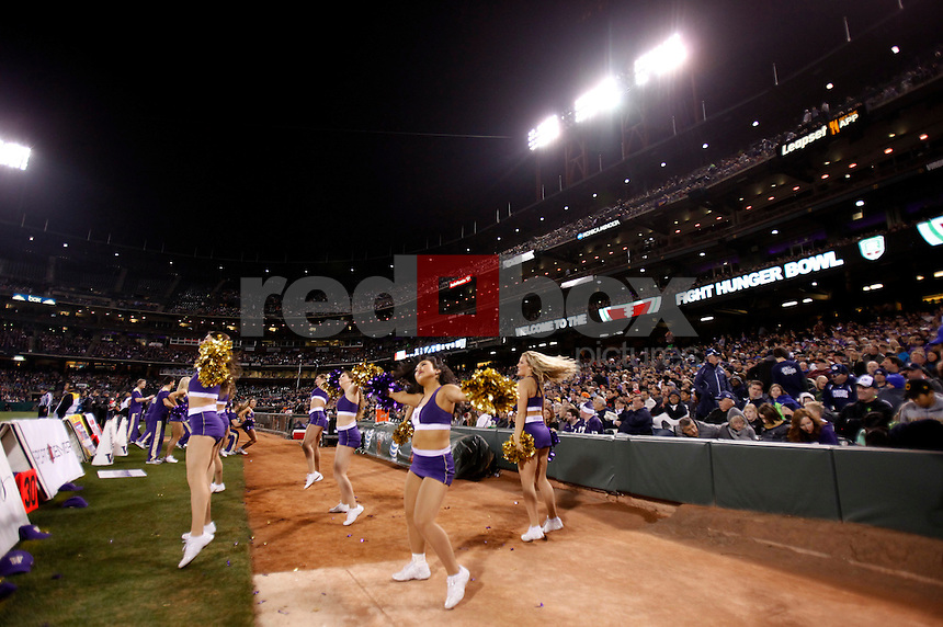 The University of Washington football team plays BYU in the Fight Hunger Bowl at AT & T Park in San Francisco on Friday December 27, 2013. (Photo by Nhat V. Meyer/Red Box Pictures)
