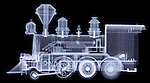 X-ray image of a steam locomotive (blue on black) by Jim Wehtje, specialist in x-ray art and design images.