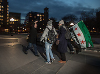 NEW YORK,NY December 16,2016: A man insults the participants of a vigil to protest against the Syrian government and the killing of innocent people in Washington Square Park, in New York City, December  16,2016. Photo by VIEWpress/Maite H. Mateo
