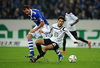 FUSSBALL   1. BUNDESLIGA   SAISON 2011/2012    9. SPIELTAG FC Schalke 04  - 1. FC Kaiserslautern                      15.10.2011 Christoph METZELDER (li, Schalke) gegen Olcay SAHAN (re, Kaiserslautern)