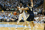 14 February 2016: North Carolina's Theo Pinson (1) and Pittsburgh's James Robinson (0). The University of North Carolina Tar Heels hosted the University of Pittsburgh Panthers at the Dean E. Smith Center in Chapel Hill, North Carolina in a 2015-16 NCAA Division I Men's Basketball game. UNC won the game 85-64.