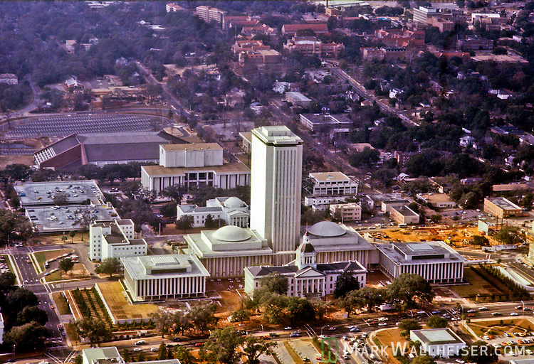 1981 Historical aerial photographs of the Florida Capitol in Tallahassee, Florida December 23, 1981. The brown dirt to the north of the Capitol is Tallahassee City Hall under construction
