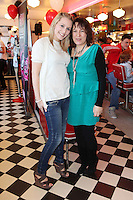 "NO REPRO FEE. 26/5/2011. NEW EDDIE ROCKET'S SHAKE SHOP. Lauren Higgs and Evyln Campbell are pictured in the new Eddie Rocket's Shake Shop. The design seeks to recall the vintage milkshake bars from 1950's America and re-imagine them for the 21st century. The new look aims to appeal to both young and old with a quirky and bold colour scheme and a concept of make-your-own milkshakes, based on the tag line ""You make it...We shake it!"". Eddie Rocket's City Diner in the Stillorgan Shopping Centre in south Dublin has re-opened after an exciting re-vamp and the addition of a Shake Shop. Ten new jobs have been created with the Diner's re-launch bringing the total working in Eddie Rocket's Stillorgan to 30. Picture James Horan/Collins Photos"