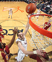 Dec. 30, 2010; Charlottesville, VA, USA; Virginia Cavaliers forward Will Regan (4) shoots the ball over Iowa State Cyclones forward Calvin Godfrey (15) during the game at the John Paul Jones Arena. Iowa State Cyclones won 60-47. Mandatory Credit: Andrew Shurtleff