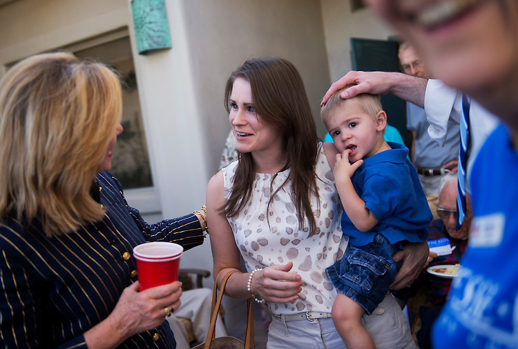 UNITED STATES - MAY 27:  Aubrey Kelly, wife of Jesse Kelly, republican contender in the AZ-08 special election, holds their son Luke, 20 months, while talking to Rep. Marsha Blackburn, R-Tenn., during a fundraiser at the home of Garland and Carolyn Cox, in Tucson, Ariz.  The winner of the election between Kelly and democrat Ron Barber on June 12th, will fill the seat occupied by former Rep. Gabrielle Giffords, D-Ariz.  (Photo By Tom Williams/CQ Roll Call)
