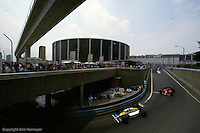 DETROIT, MI - JUNE 22: Nelson Piquet in the Williams FW11/Honda RA166E drives ahead of Stefan Johansson in the Ferrari F1-86/Ferrari 032 during the Detroit Grand Prix on June 22, 1986, on the Detroit temporary street course in Detroit, Michigan.