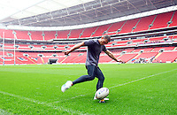 PICTURE BY VAUGHN RIDLEY/SWPIX.COM...Rugby League - Carnegie Challenge Cup 2011 - Leeds Rhinos Wembley Walkabout - Wembley Stadium, London, England - 26/08/11...Leeds Kevin Sinfield practices his kicks during the Leeds Rhinos Wembley Walkabout.