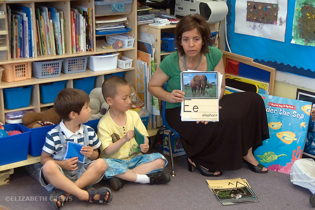 Berkeley CA  Preschool teacher using alphabet cards and pictures to teach students their letters