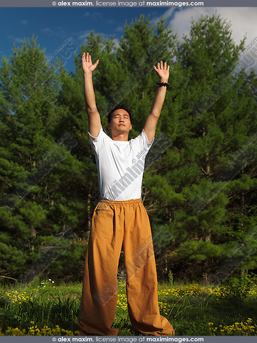 Portrait of a man practicing sunrise Qi Gong meditation in the nature. Qigong, chi kung, chi gung. Instructor Shi Chang Dao,  Shaolin Temple STQI Toronto.