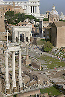 Temple of Castor and Pollux, 484 BC, restored 117 BC, totally rebuilt 1st century AD, Arch of Septimus Severus (203 AD), Santi Luca e Martina (16th century), and Monument to Vittorio Emanuele II (20th century) in the distance, Roman Forum, Rome, Italy, Europe.