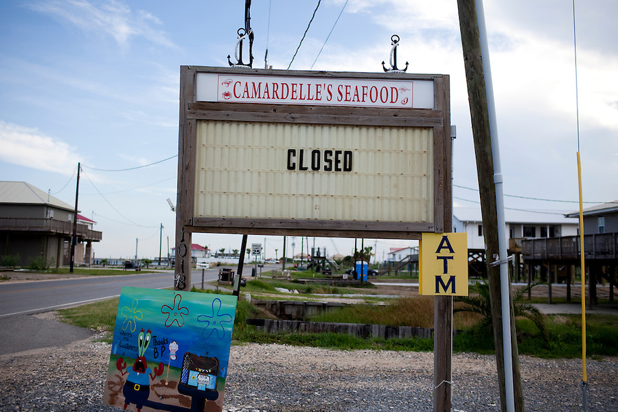 A sign for Camardelle's Seafood marks closed in Grand Isle, LA on June 24, 2010 where a fishing ban and closed beaches  due to the B.P. oil spill have killed the tourist industry there.