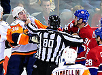 26 October 2009: New York Islanders' defenseman Jack Hillen (38)squares off against Montreal Canadiens right wing forward Matt D'Agostini (36) during the first period at the Bell Centre in Montreal, Quebec, Canada. The Canadiens defeated the Islanders 3-2 in sudden death overtime for their 4th consecutive win. Mandatory Credit: Ed Wolfstein Photo