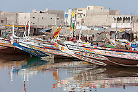 Senegal, Saint Louis.  Guet N'Dar Neighborhood, Brightly Decorated Fishing Boats Tied up along the Senegal River.