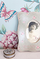 A vintage photograph in a floral print frame is testament to Ilse's love of nostalgic romance in the decoration and furnishings of her home